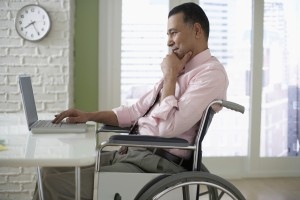 Businessman Working on His Laptop ERISA Disability Claim Lawyer