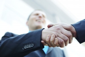 Our New York Employment Attorneys Business handshake after signing new contract